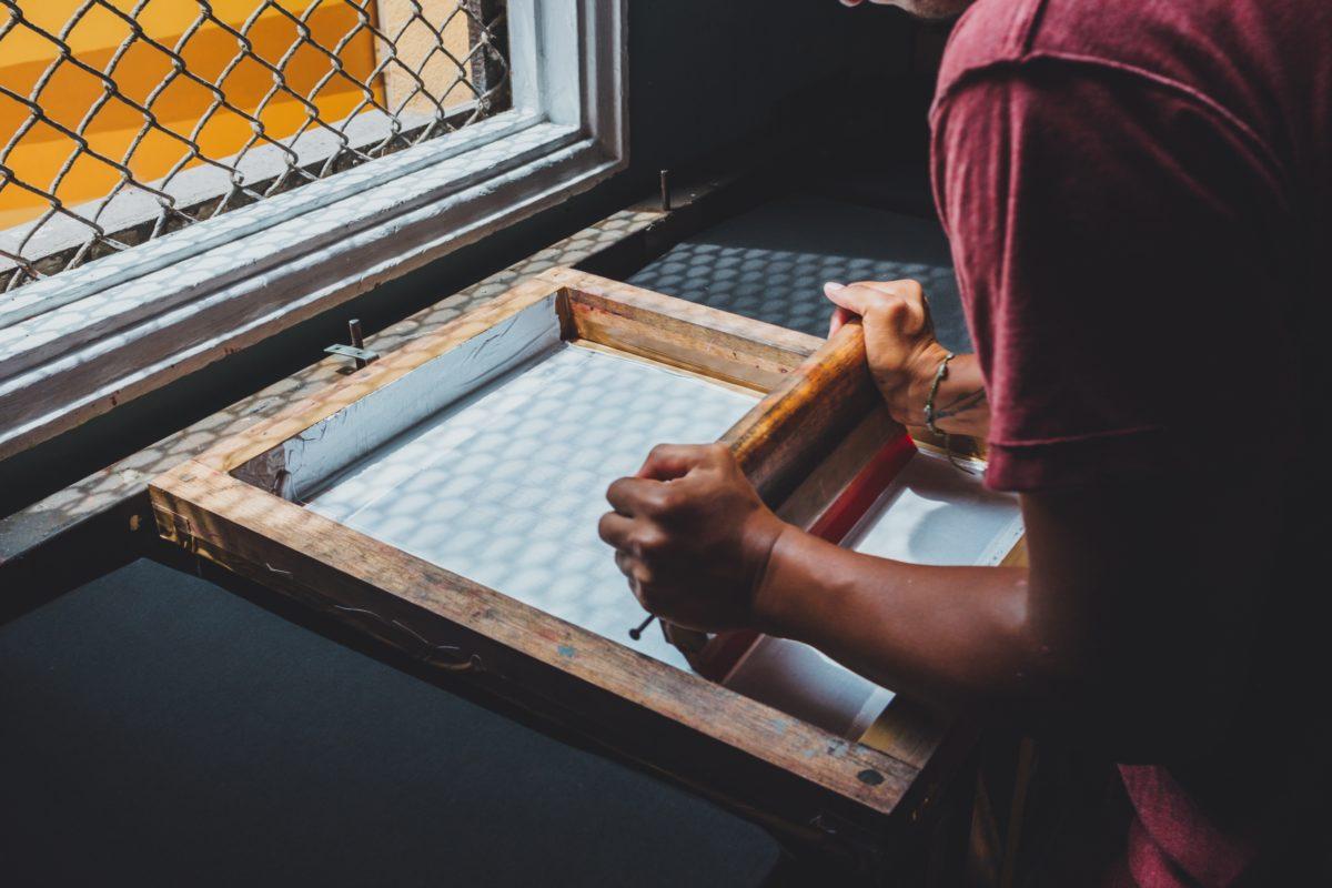 Man screen printing a shirt